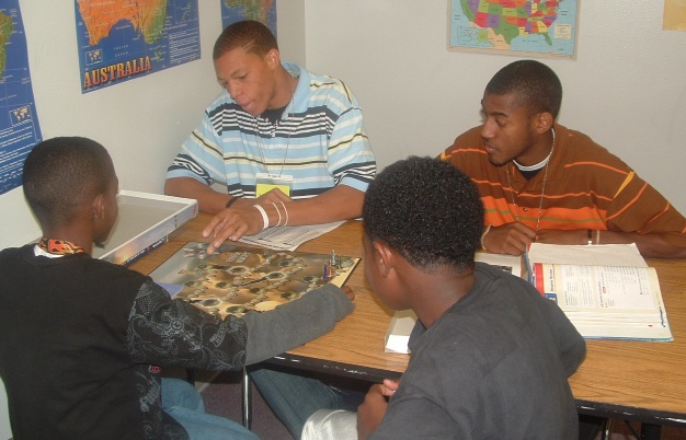 Middle school tutors Dominque Godwin and Jarrett Brandon are shown with students.