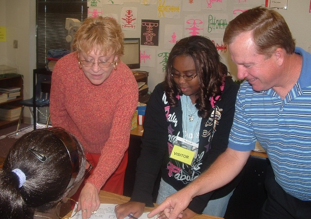 Middle school tutor Ariel Williams with teachers LaDonna Cook and Vic Brumley